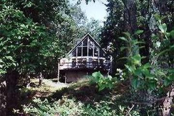 Pet Friendly Four Seasons Lakefront Chalet with Private Dock