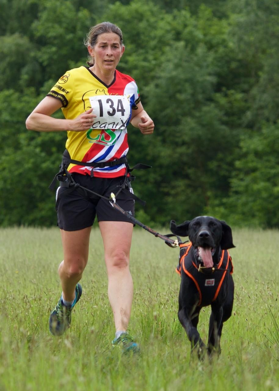 An athlete goes Canicross running with her dog.
