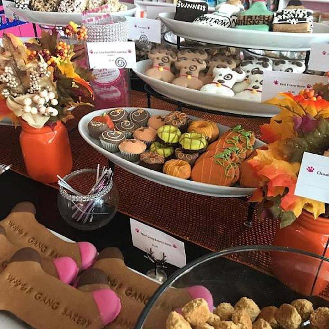Get decorated dog cookies and pumpkin treats and more at Woof Gang Bakery & Grooming locations.