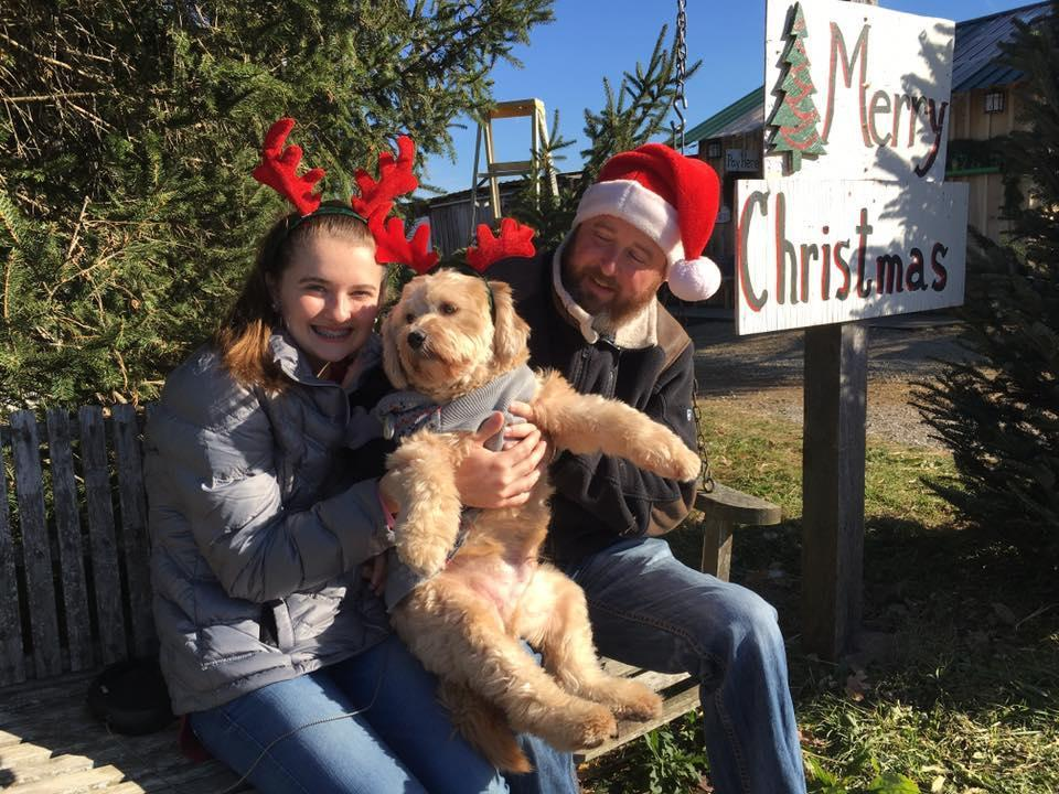 A Family and Their Dog Wears Reindeer Antlers at Pet-Friendly Baldwin Farms.