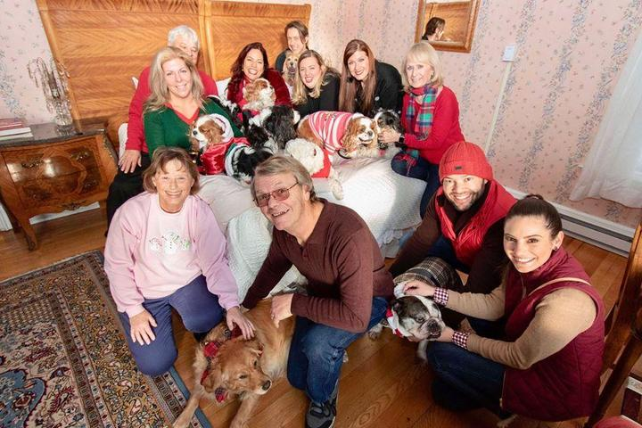 Slumber Party Attendees Pose for a Photo at the Dog-Friendly Event at the Wilburton Inn.