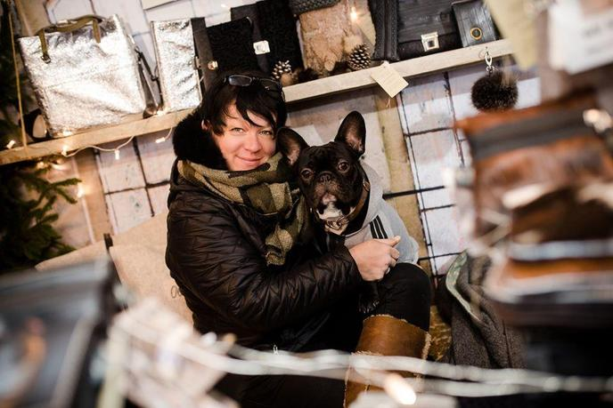 A Woman Poses With Her Dog at a Pet-Friendly Christmas Market in Germany.