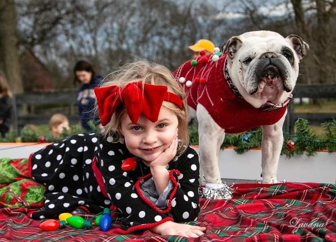 A Girl and a Pug Pose for a Photo at Leiper's Fork Christmas Parade in Franklin.