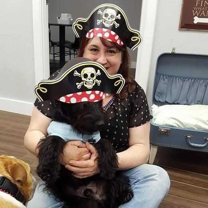 A Woman and a Scottie Wear Pirate Hats.