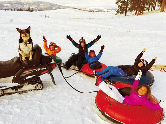 A Family Snow Tubes at a Dog-Friendly Resort in Greenough.