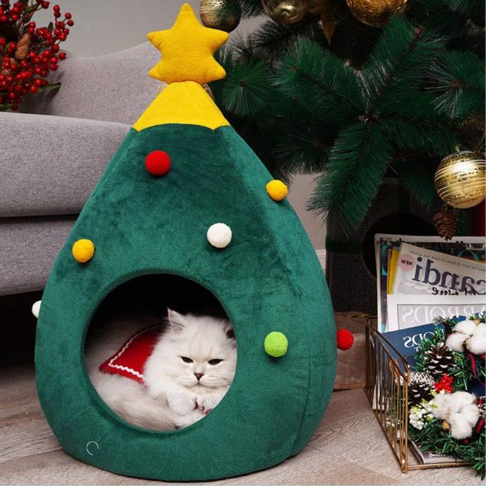 A Cat Sleeps In a Christmas Cozy Cat Bed.