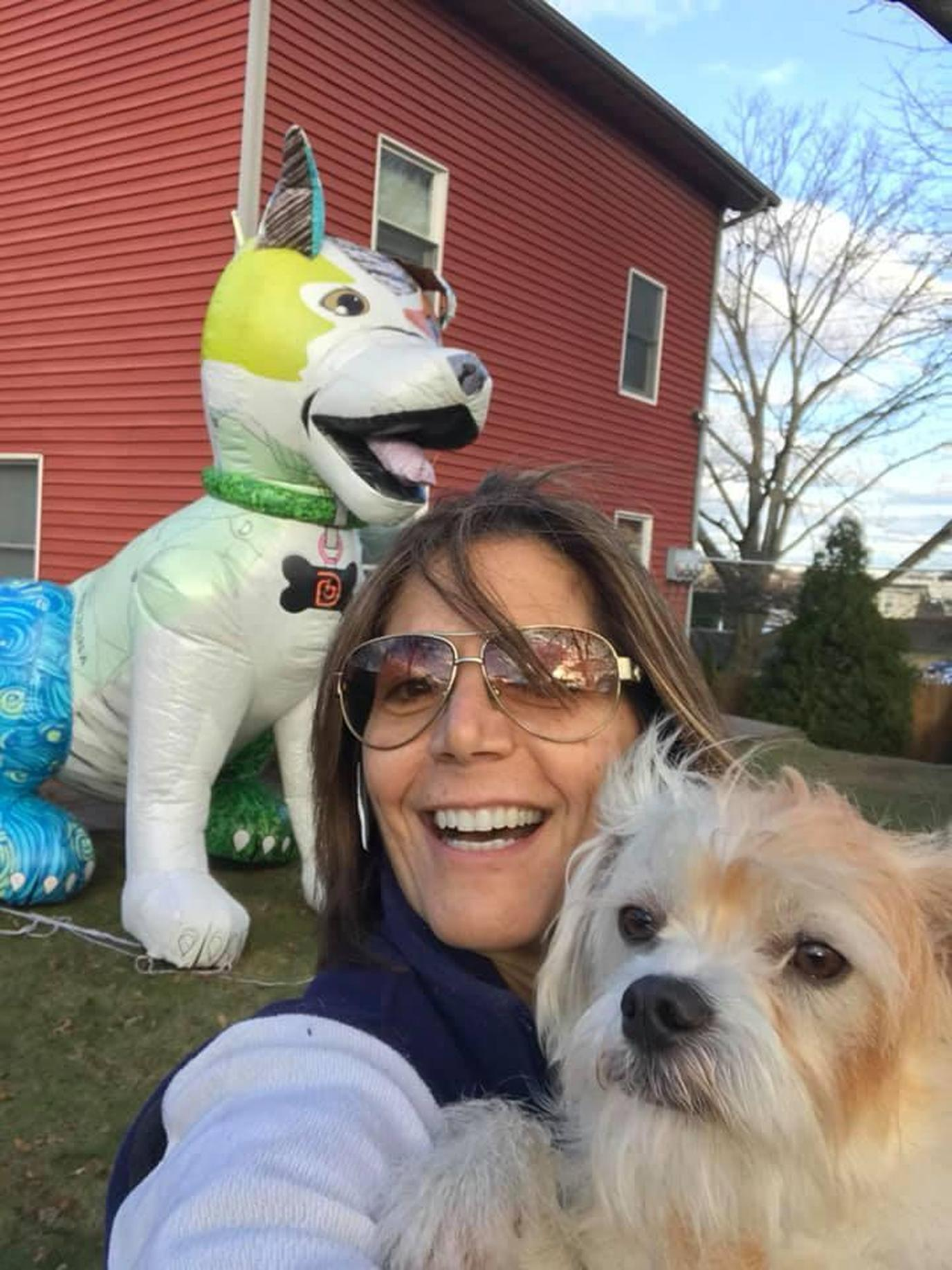 A Woman Takes a Selfie With Her Dog at a Pet-Friendly Christmas Race in New York.