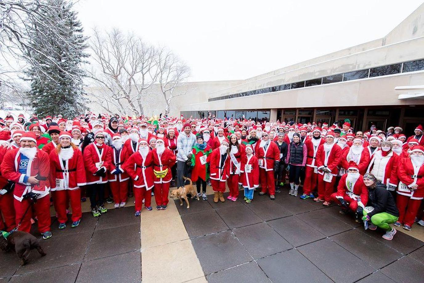 A Group of Santas Pose at a Pet-Friendly Event in North Dakota.