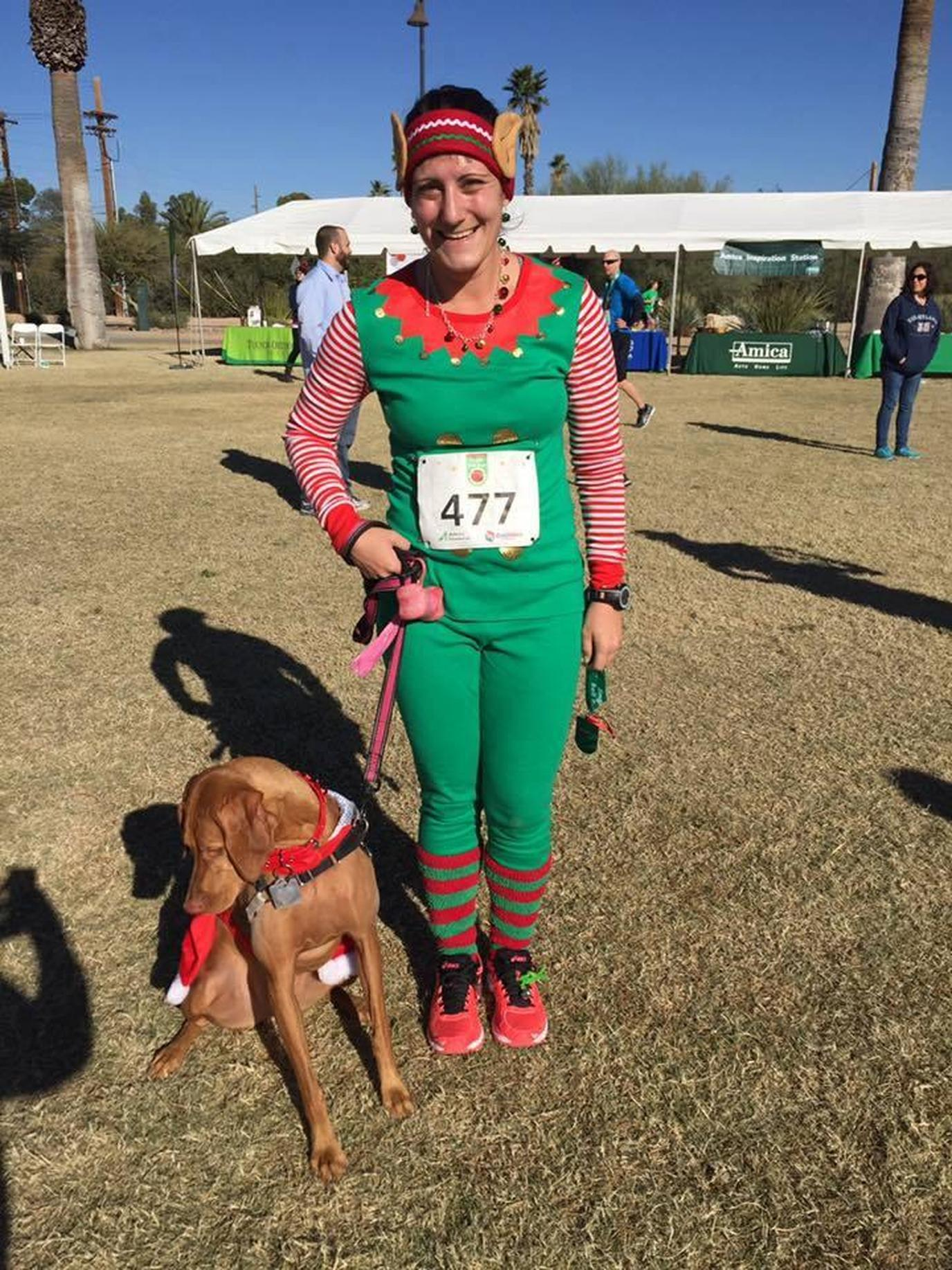 A Woman in an Elf Costume Gets Ready for a Pet-Friendly Christmas Race in Tuscon.
