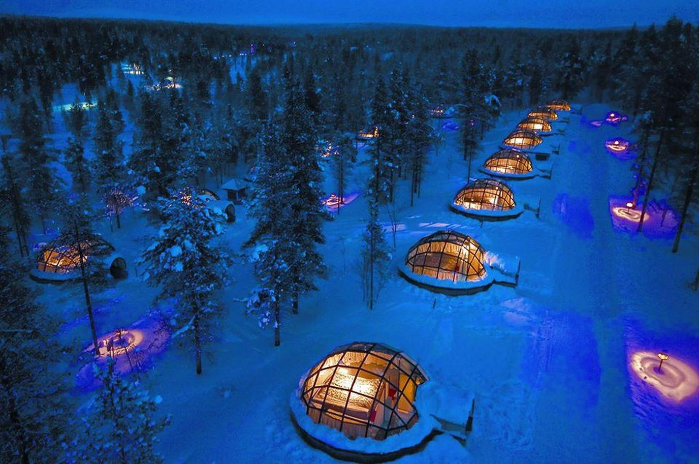 Stay in style at the dog-friendly Kakslauttanen Hotel in Finland.