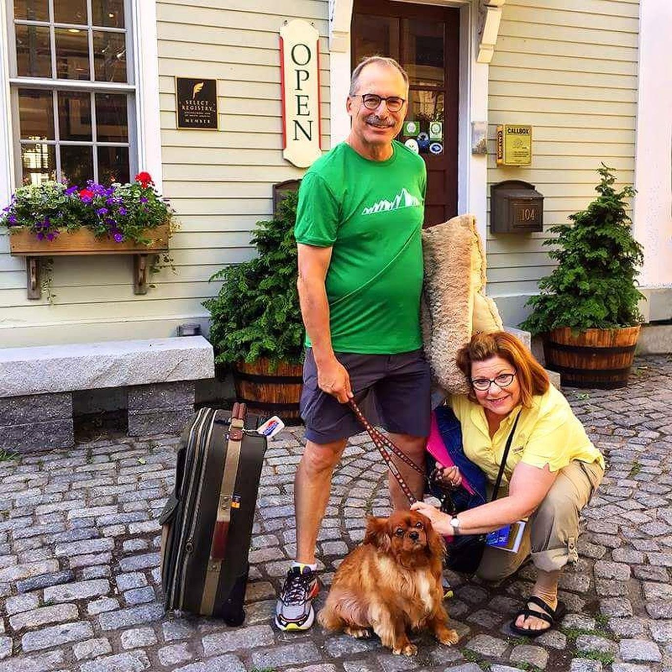 A Man and Woman Checking In Snap a Photo In Front of a Pet-Friendly Hotel in Provincetown