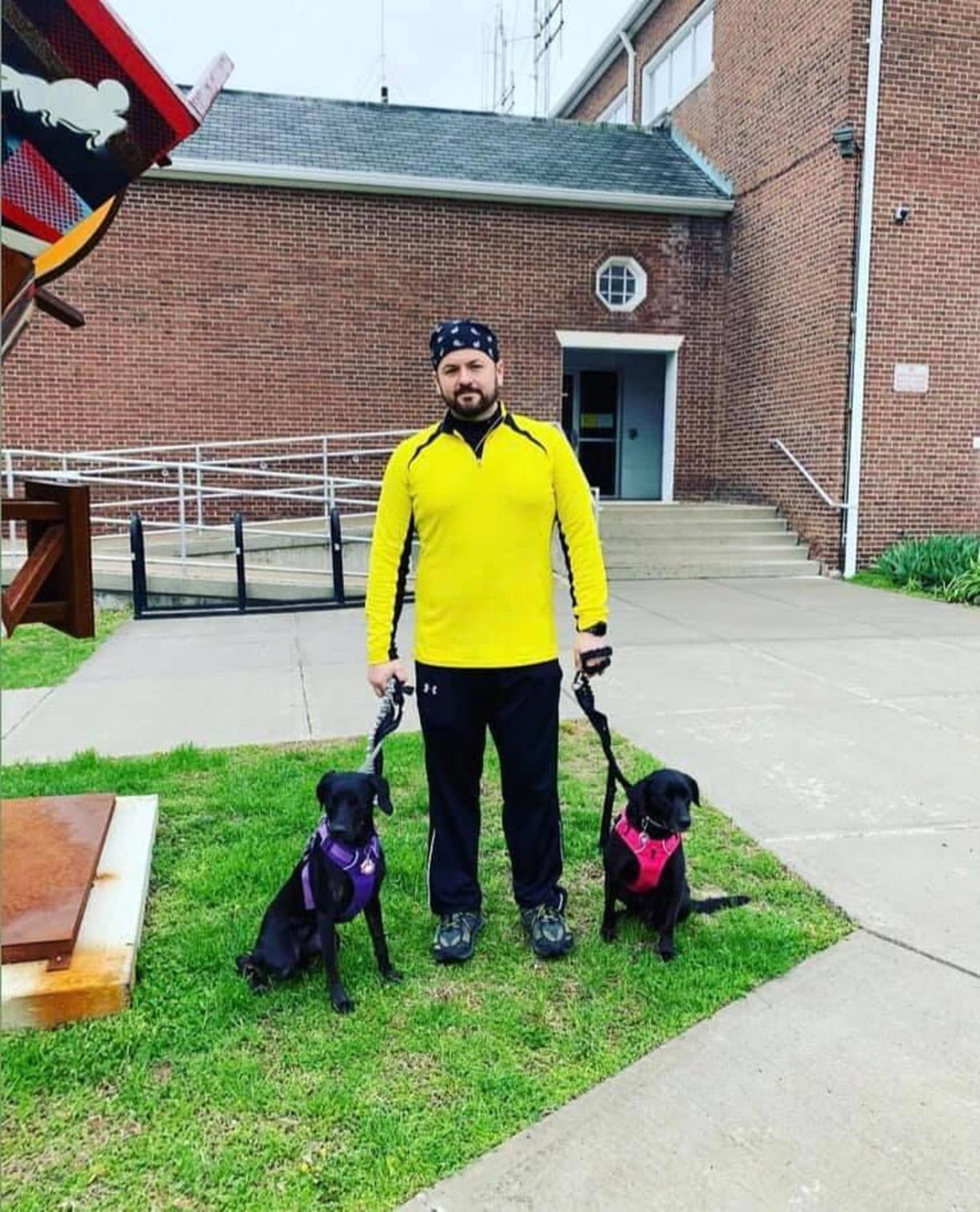A Man Poses With Two Dogs Before Going on a Pet-Friendly Spring Run in Bethel.