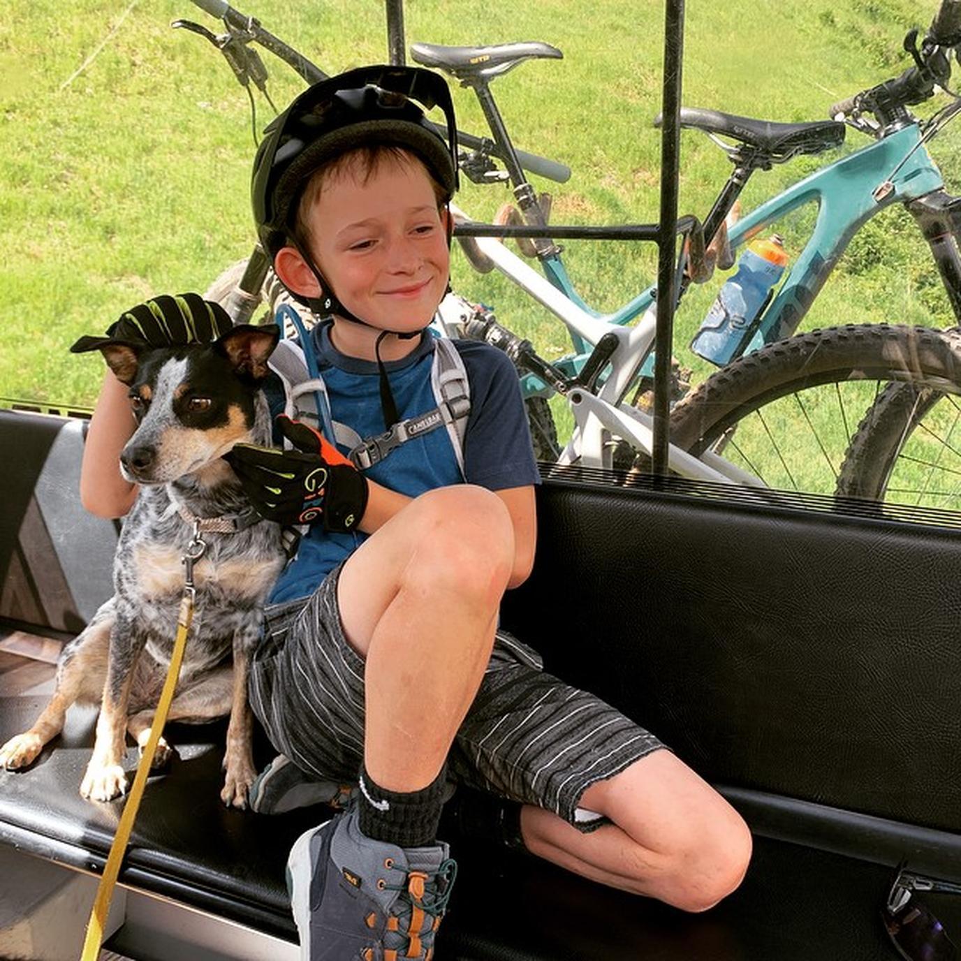 A boy rides a dog-friendly gondola in Telluride.