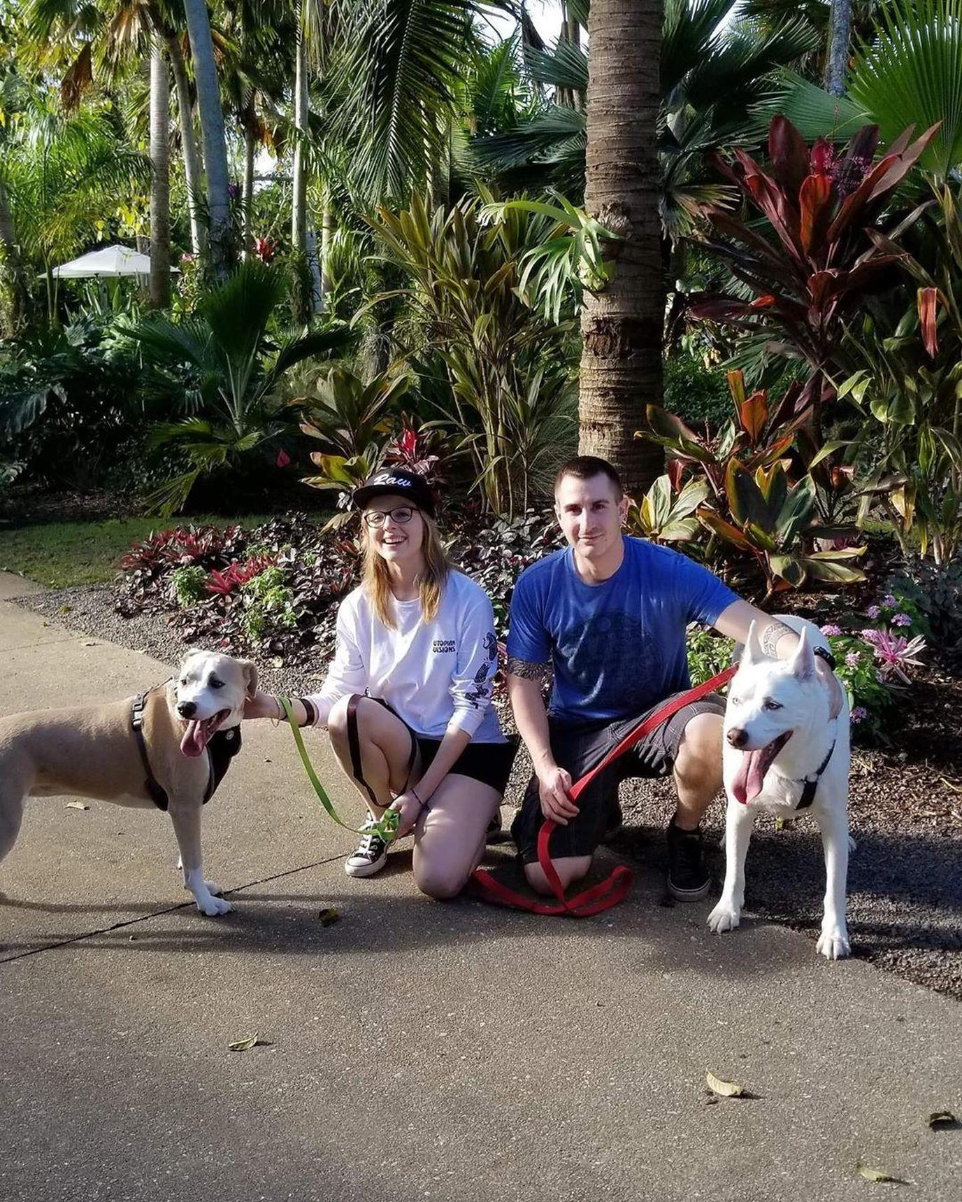 A Couple Poses With Their Dogs in Pet-Friendly Naples.