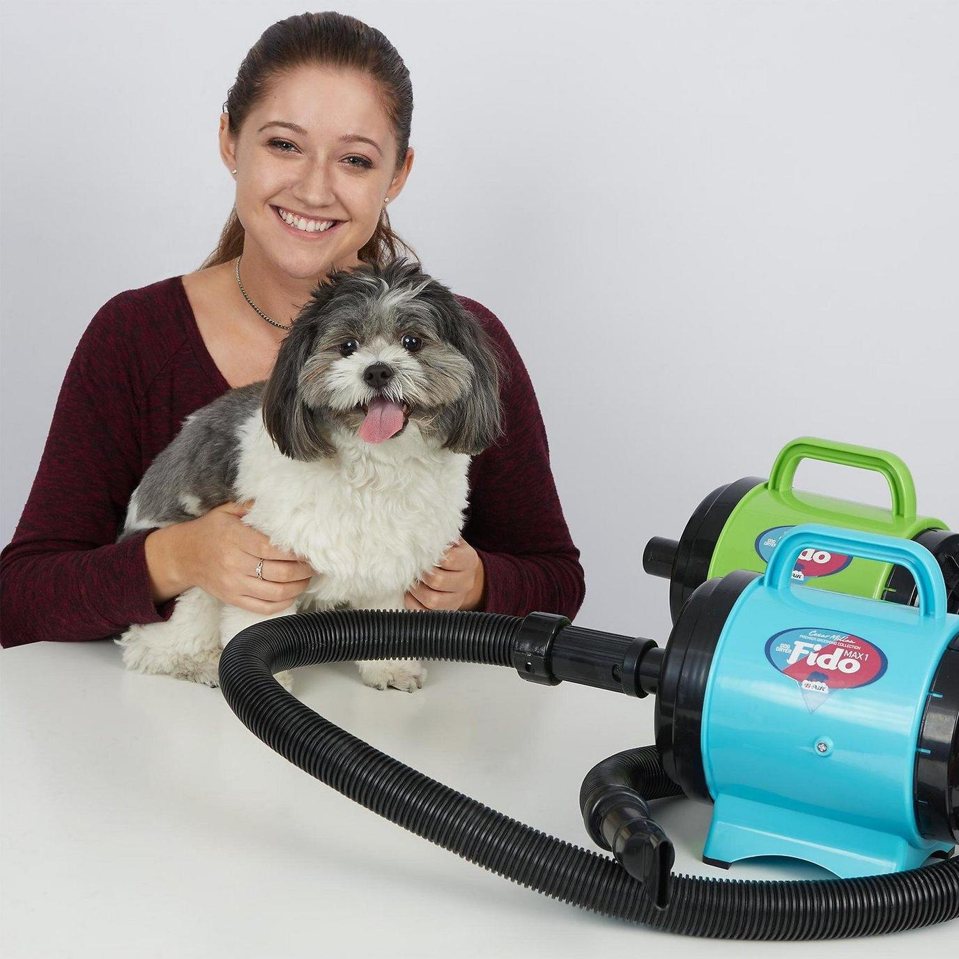 A Woman Poses With Her Dog Beside the B-Air Fido Max 1 Dog Dryer.
