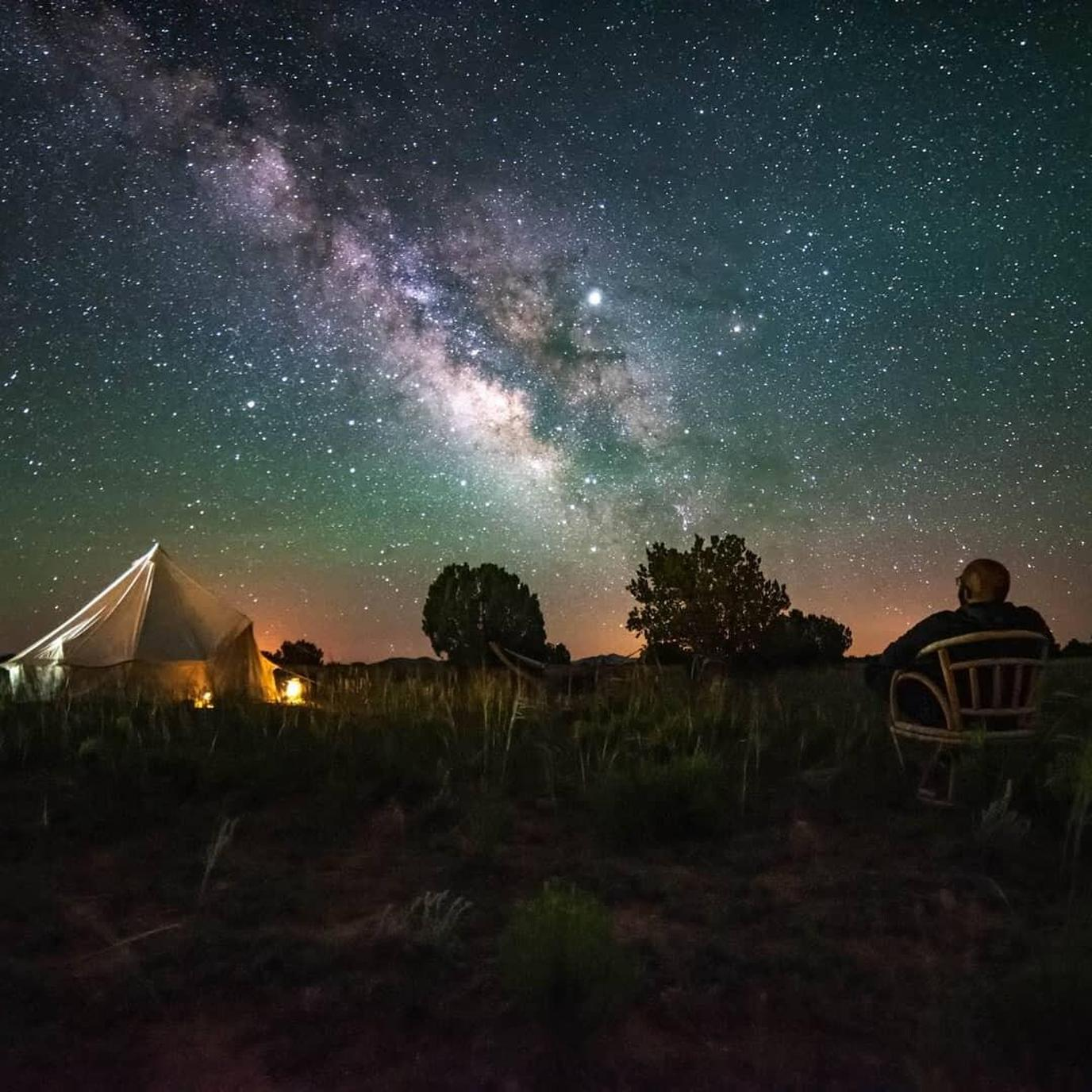 Man Stargazes at a Pet-Friendly Vacation Rental Near Grand Canyon National Park.