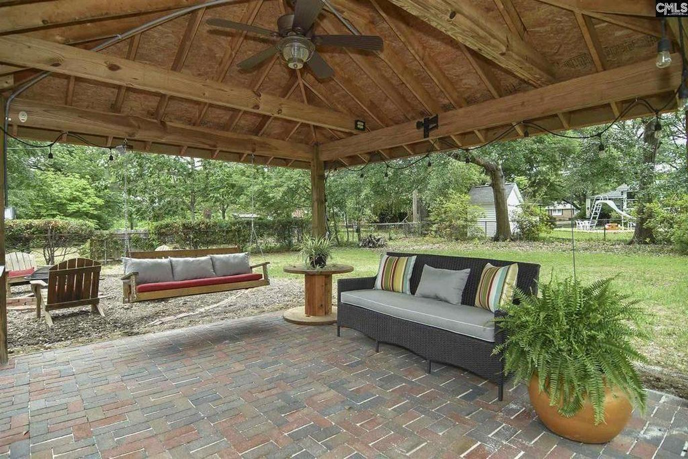 Covered Porch at a Pet-Friendly Vacation Rental Near Congaree National Park.
