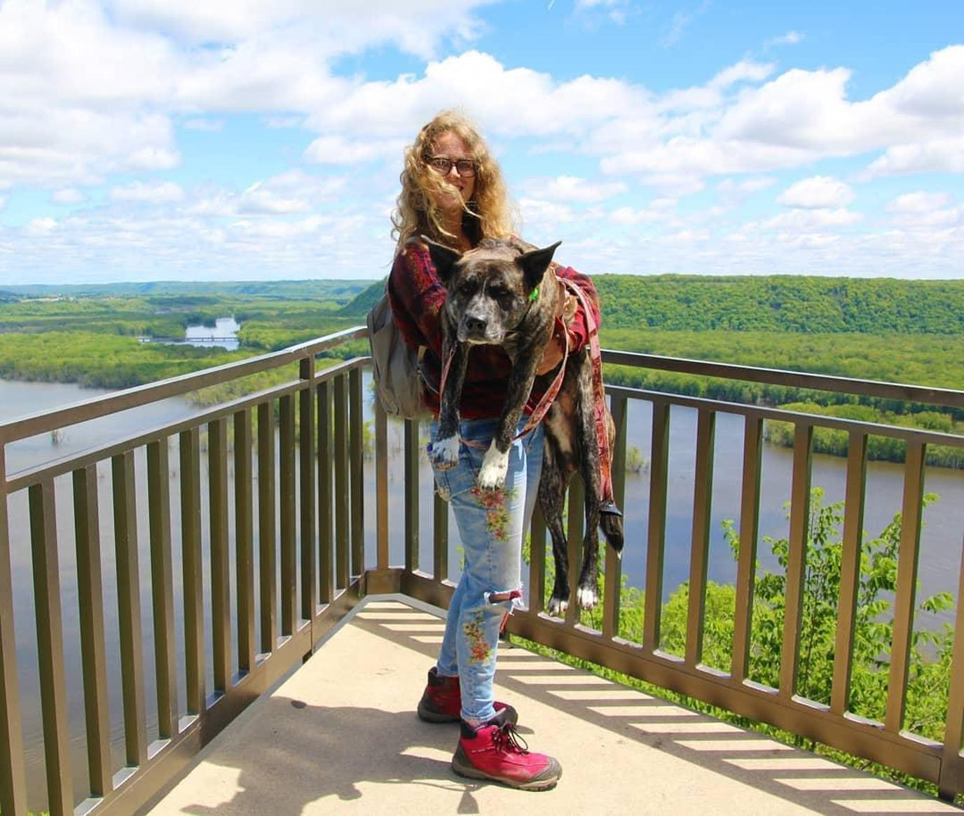 A woman and her dog at Pikes Peak State Park on a Pet-Friendly Road Trip