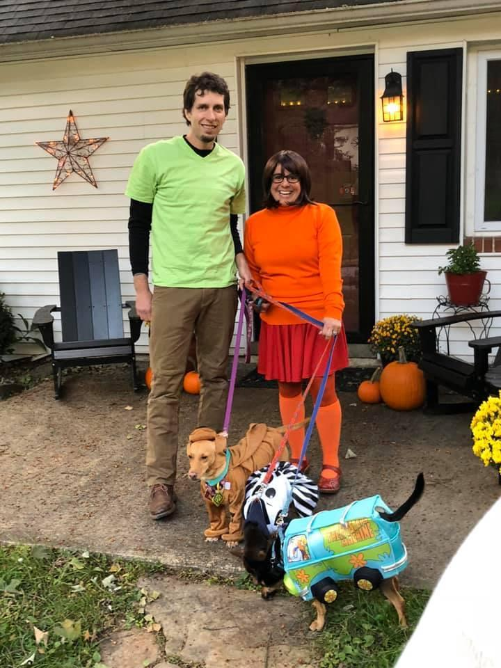 A Family Is Dressed in Halloween Costumes as the Characters From Scooby-Doo.